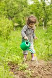 Little kid in the garden Royalty Free Stock Photo