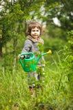 Little kid in the garden Royalty Free Stock Photos