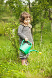 Little kid in the garden Royalty Free Stock Images