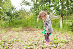 Little kid in the garden Stock Photography