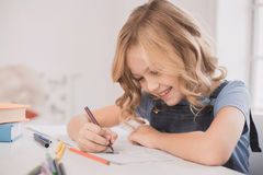 Little kid girl drawing at home creativity development Stock Photos