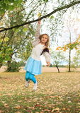 Little kid - girl hanging on branch Royalty Free Stock Photos