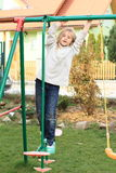 Little kid - girl hanging contruction Royalty Free Stock Photos