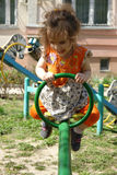 Little kid girl having fun on playground on sunny spring day Royalty Free Stock Photography