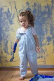 Little kid girl helping making renovation at house room. Royalty Free Stock Photo
