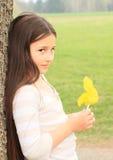 Little kid - girl leaning on tree Stock Image