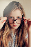 Little kid girl looking happy wearing glasses. Vintage portrait Royalty Free Stock Images