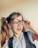 Little kid girl looking happy wearing glasses. Vintage portrait Royalty Free Stock Image