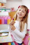 Little kid girl painting. At home royalty free stock images