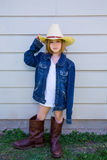 Little kid girl pretending to be a cowboy Stock Images