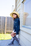 Little kid girl pretending to be a cowboy Stock Photo
