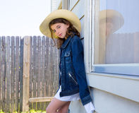 Little kid girl pretending to be a cowboy Stock Photos