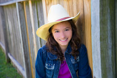 Little kid girl pretending to be a cowboy with hat Royalty Free Stock Photos
