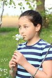 Little kid - girl smelling a blossom Stock Images