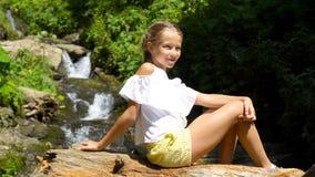 Little girl enjoying view of waterfall in Krasnay Poliana stock video footage