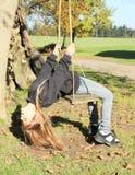 Little kid - girl on swing Stock Photo