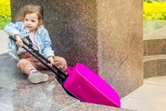 Little kid girl with travel suitcase outdoors. Royalty Free Stock Photo
