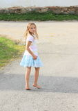 Little kid - girl walking barefoot Stock Image