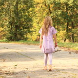 Little kid - girl walking barefoot Stock Images