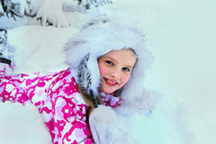 Little kid girl in winter clothes with falling Royalty Free Stock Photos