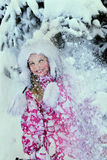 Little kid girl in winter clothes with falling Stock Images