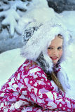 Little kid girl in winter clothes playing snow Royalty Free Stock Photo