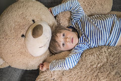 Little kid hanging out with his teddy Stock Photos