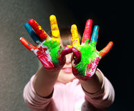 Little kid have fun. Cute little kid with painted hand royalty free stock images