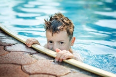 Little kid hide in pool Royalty Free Stock Photos