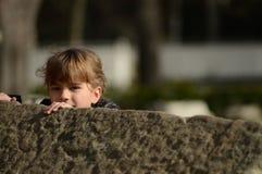 Little kid hiding Royalty Free Stock Photo