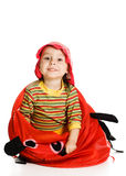 Little kid hiding. Little kid looking out of basket on a white background Royalty Free Stock Image