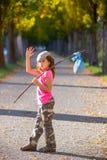 Little kid with hobo stick bag and bundle girl saying goodbye. With hand stock images