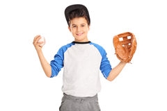Little kid holding a baseball. Little kid with baseball glove holding a baseball and looking at the camera isolated on white background royalty free stock photo