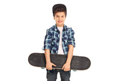 Little kid holding a skateboard. Little kid with a blue cap and checkered shirt holding a skateboard isolated on white background Royalty Free Stock Photos