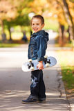 Little kid holding skateboard Stock Photography