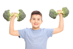 Little kid holding two broccoli dumbbells Royalty Free Stock Image