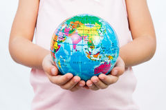 Little Kid Holding World Globe on Her Hands Royalty Free Stock Images