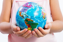 Little Kid Holding World Globe on Her Hands Royalty Free Stock Image