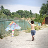 Little kid with kite Royalty Free Stock Photo