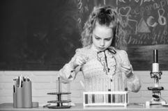 Little kid learning chemistry in lab. Happy children. Chemistry lesson. students do biology experiments with microscope royalty free stock image
