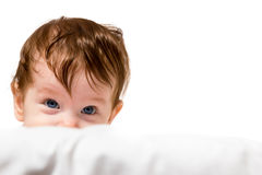 Little kid look out and smiling Royalty Free Stock Images