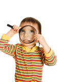 Little kid looking through a magnifying glass Royalty Free Stock Photography