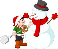 Little kid making a snowman Stock Photos