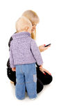 Little kid in the mobile phone, the mother Stock Photo