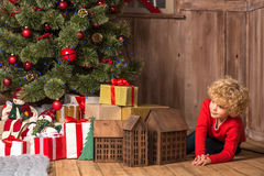 Little kid near pile of gift boxes Royalty Free Stock Photos