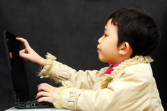 Little kid with notebook computer Royalty Free Stock Photography