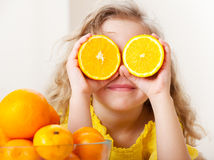 Little kid with oranges Royalty Free Stock Photos
