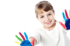 Little kid with painted hands. Portrait of a cute girl with painted hands royalty free stock photos