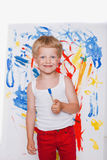 Little kid painting with paintbrush picture on easel. Education. Creativity Royalty Free Stock Photo