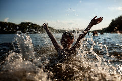 Little kid play in water and making splash; Stock Photos